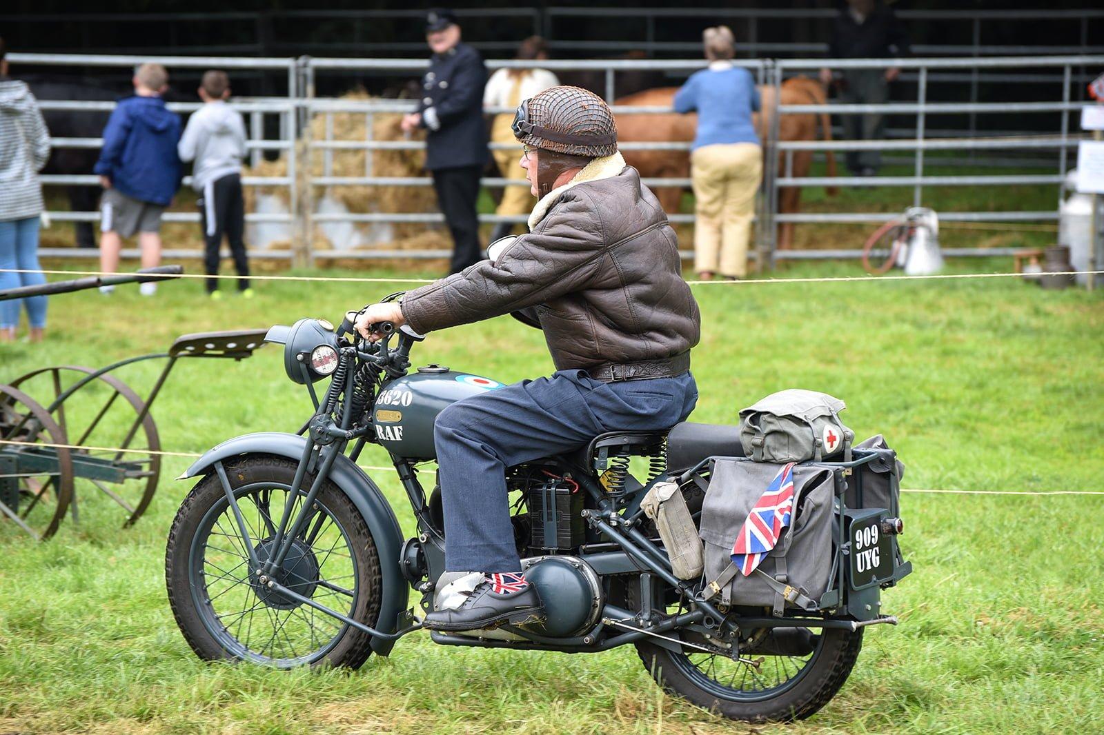 War time RAF motorbike being ridden
