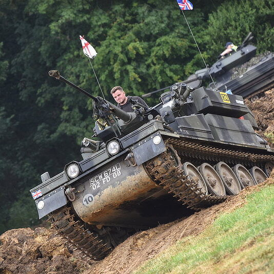 Capel Military Show tracked vehicle coming out of a ditch